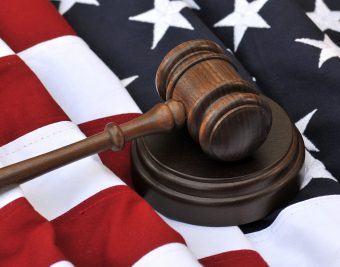 United States flag with a gavel lying on it