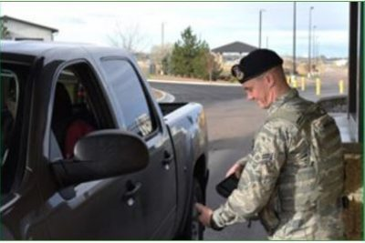 Airman scanning ID of motorist