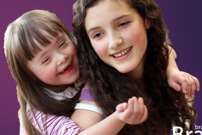 A dark purple background, foreground shows a girl smiling and looking over her shoulder; she is carrying a younger girl on her back. The younger girl has Down syndrome. Includes the logo for the Branch, Military Parent Technical Assistance Center.